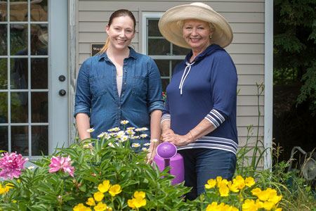 Lifecare at RiverMead - two women with flowers