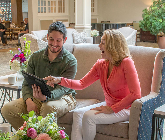 couple looking at iPad on couch